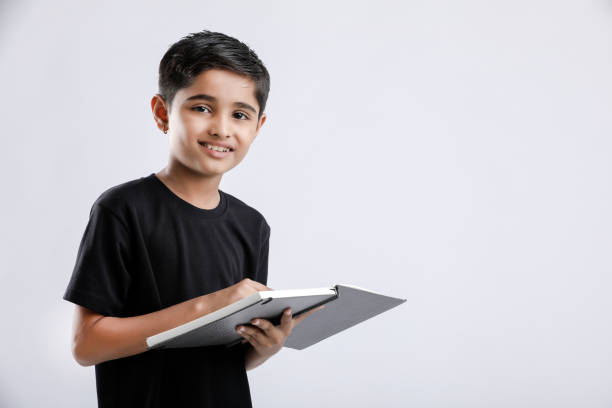 little Indian / Asian boy with book on head